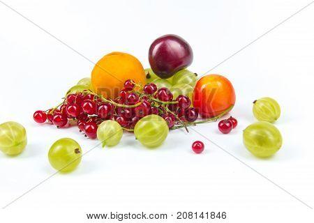 Various summer Fresh berries in a white background.. Antioxidants, detox diet, organic fruits