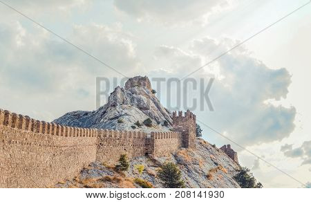 Genoese fortress in Sudak, the Crimea Peninsula, Black sea. Consular castle and the fortification wall of the upper tier. Part of the wall, Museum-reserve