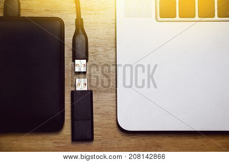 usb storage data flash drive and external hard disk with computer notebook