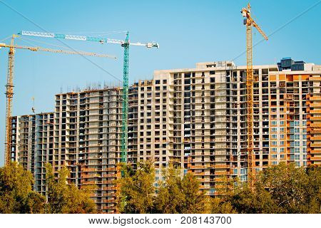 construction of multi-storey houses on the shore of a beautiful lake