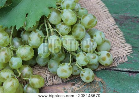 Grapes in a wicker basket on wooden boards
