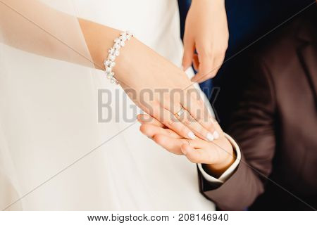 Marry me. Bride and groom's hands with wedding rings