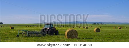 Tractor With Rototiller Attached In A Hay Field