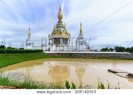 Magnificent Wat Thung Setthi (The Great Jewel Chedi of the three worlds) in beautiful day and reflection Khon Kaen Thailand