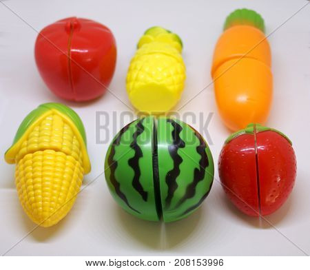 Plastic colorful vegetables and fruits which possible to cut