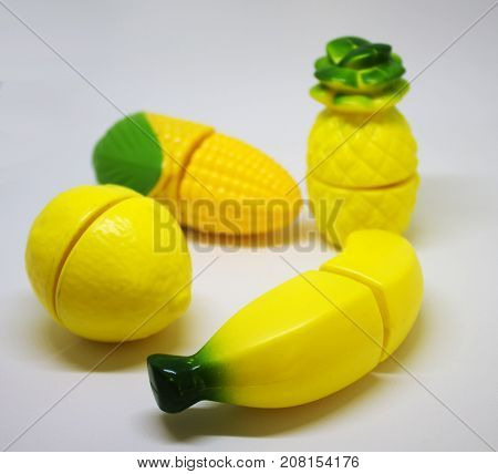 Plastic yellow vegetables and fruits which possible to cut