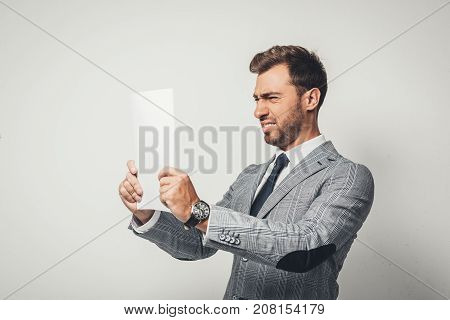 Businessman Looking At Paper