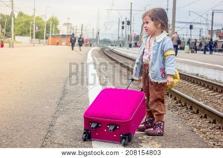 Little girl crying on the railway station, she dont want to leave
