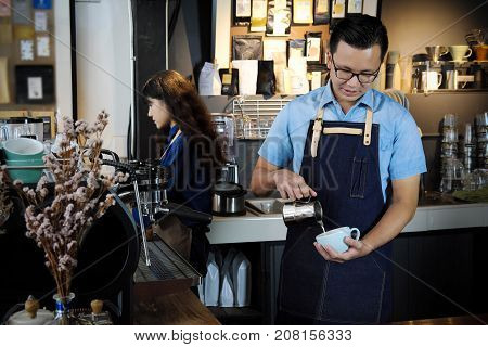 Portrait Of Barista Making Latte Or Cappucino Coffee In Coffee Shop. Cafe Restaurant Service, Food A