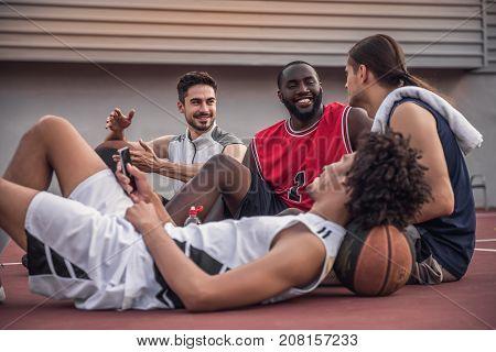Guys Playing Basketball
