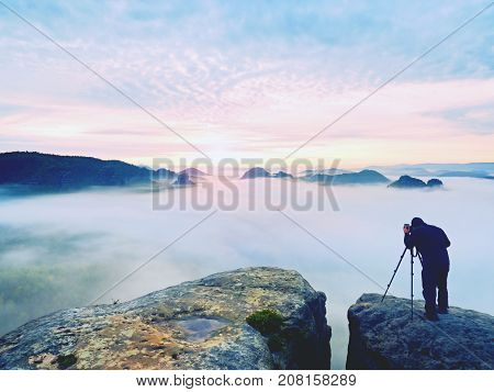 Photo Artist In Work. Photographer In Mountains. Traveller Takes Photos Of Majestic Landscape,