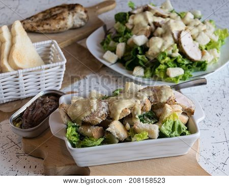 Excellent caesar salad with roasted pastry and chicken, sprinkled with parmesan cheese