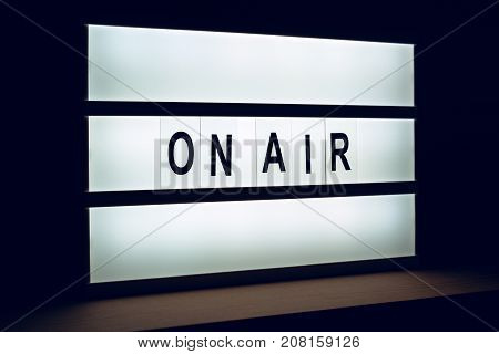 Vintage On Air live broadcast sign in radio or television studio blinking