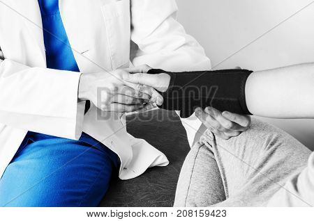 Doctor Is Checking The Wrist To A Patient After Putting A Wristband In Silhouette, Color And Black A