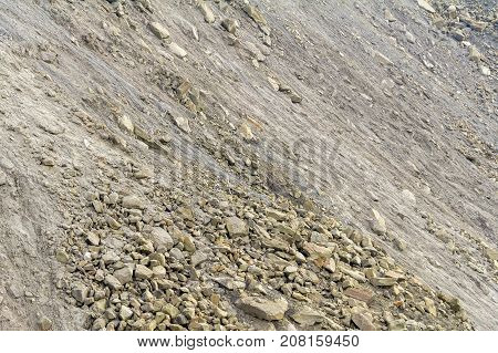 full frame shot of a hill with lots of stones and pebbles