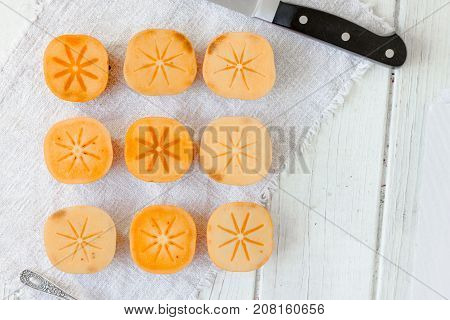 Top view of group of persimmon fruits on white background