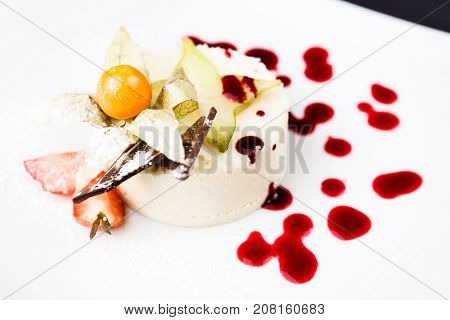 Panna cotta with white chocolate served on a white plate