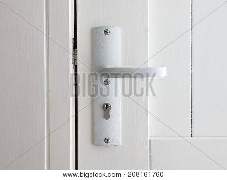 White door with chrome doorhandle selective focus