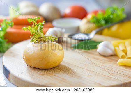 Kitchen board with fresh ripe yellow turnip
