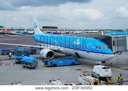 AMSTERDAM, HOLLAND - July 27: KLM plane being loaded at Schiphol Airport on July 27 2017 in Amsterdam, Netherlands. The process of loading baggage into the aircraft and preparing for flight