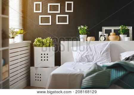 bedroom interior with bed window and blackboard wall