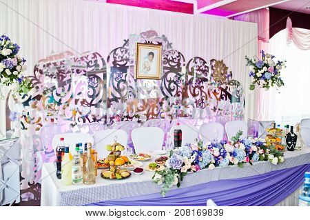 Awesome Decorated Wedding Tables With Various Dishes And Floral Decorations.