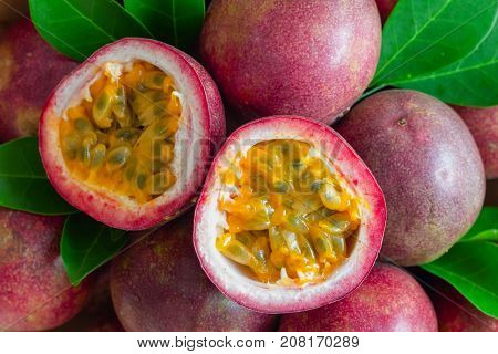Fresh passion fruit on wood table in top view flat lay for background or wallpaper. Ripe passion fruit so delicious sweet and sour. Close up on half of passion fruit in macro concept. Tropical fruit. Passion fruit background macro concept.