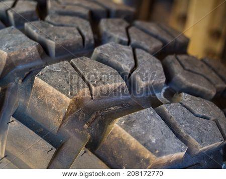 Closeup of aggressive offroad mud tire tread on 4x4.