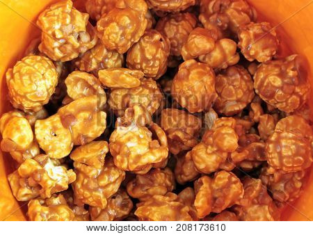 Close up of Caramel Popcorn in an yellow Bowl