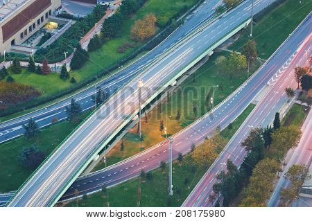 Aerial View Above of Highway Road Junctions at Sunset. The Intersecting Freeway Road Overpass The Financial center of Istanbul.