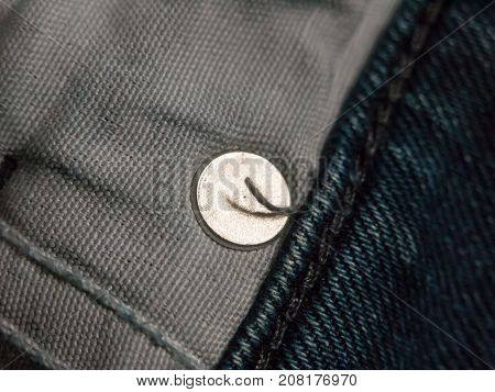 Close Up Of Inside Of Pocket Of Jeans With Metal Circle