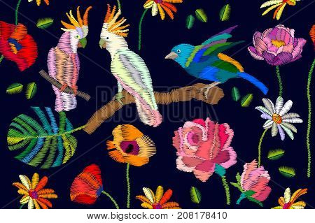 Seamless vector pattern with parrots flowers and palm leaves on black background. Stylized embroidered texture. Vintage motifs.
