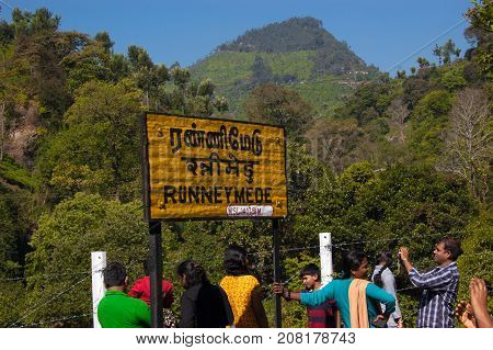 OOTY, TAMIL NADU, INDIA, 20 March 2015 : Nilgiri. Railroad sign Runneymede written in Tamil official language of Tamilnadu , Hindi and English on a platform of the railway station