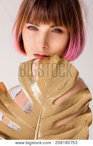 Woman Posing With Golden Palm Leaf