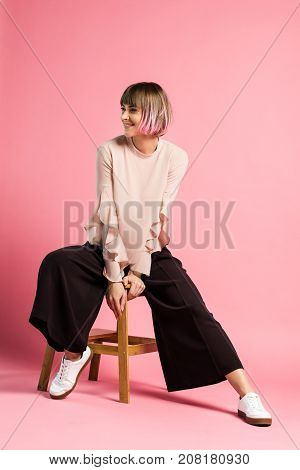 Smiling Woman Sitting On Stool