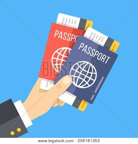 Hand holding two passports with tickets. Vector illustration isolated on blue background