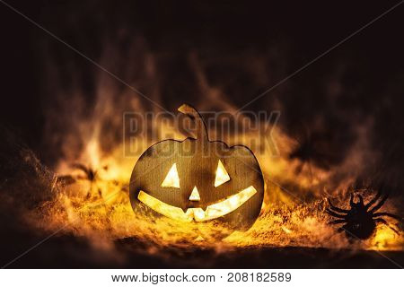 Halloween pumpkin grinning facemysteryspiders on web nare mysterie