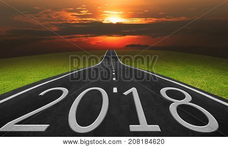 Asphalt road and landscape background with 2018 words Business concept in 2018.