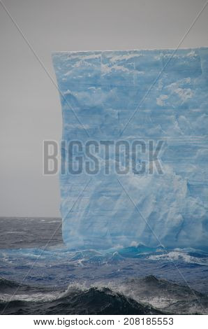 A large tabular iceberg floating in the southern atlantic ocean, near Antarctica.