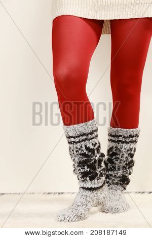 Woman Legs Wearing Woolen Socks And Red Tights