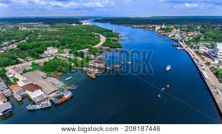 Aerial View Of Estuary, River And Community