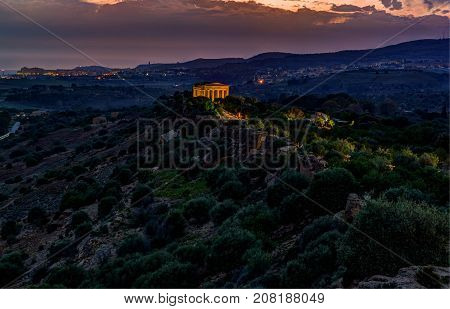 The famous Temple of Concordia in the Valley of Temples near Agrigento, Sicily. Night landscape with temple in night illumination