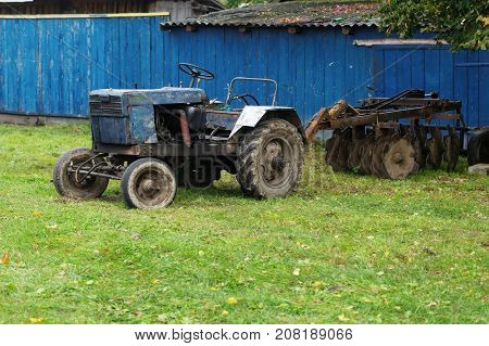 Homemade Village Tractor Parked Outside The Yard