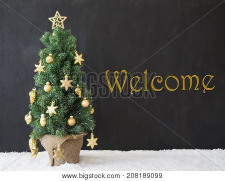 English Text Welcome. Golden Decorated Christmas Tree With Black Concrete Or Cement Background. Modern Urban Style With Snow