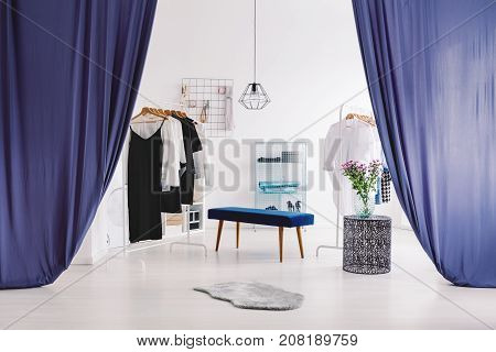 Sophisticated Dressing-room With Blue Curtains