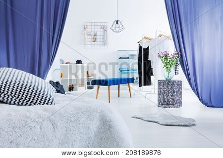 Multifunctional Bedroom With Blue Curtains