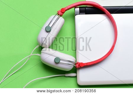 Electronics Isolated On Green Background. Music And Digital Equipment Concept