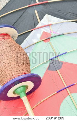 Background of colorful Indian Kite with threads called Manjha in vertical frame