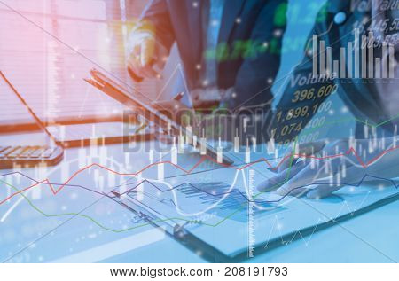 Business strategy invesment consept : Two businessman confident executive colleagues meeting and discussing at office with profit graph background.