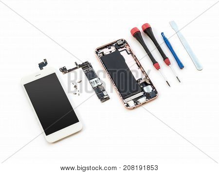 Disassembled broken smartphone preparing to repair or replace new part on white background